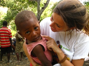 Me with a little one during cholera kit distributions in Haiti