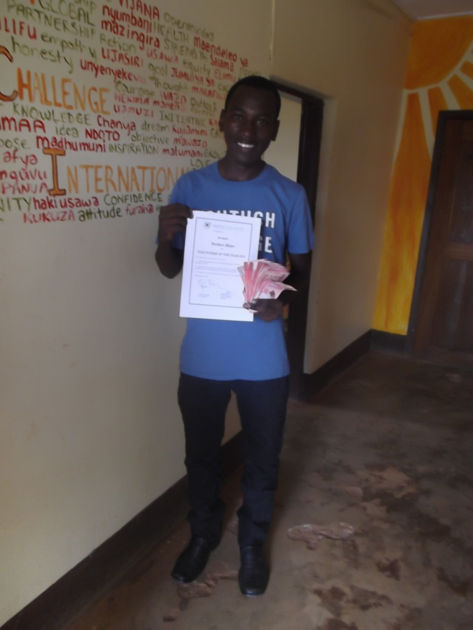 Norbert with his Volunteer of the Year certificate and prize winnings!