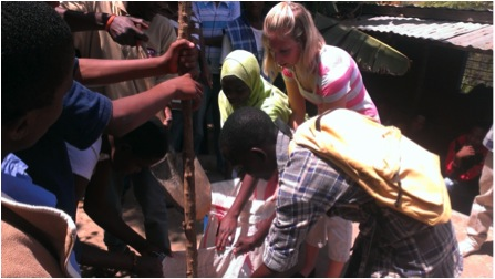 Danielle building compost sack with Umoja students