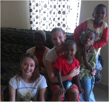 Danielle and Bhreagh with the kids from House of Happiness