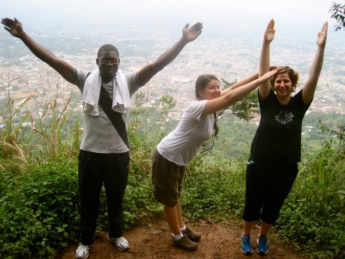 Spelling out YCI after hiking up a mountain in Koforidua